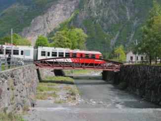 Train, bridge and river Trient. Vernayaz, Martigny, Switzerland